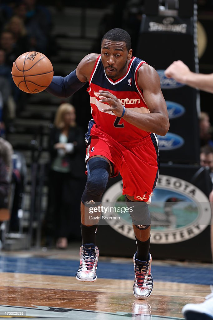 John Wall #2 of the Washington Wizards dribbles the ball up the court against the Minnesota Timberwolves during the game on March 6, 2013 at Target Center in Minneapolis, Minnesota.