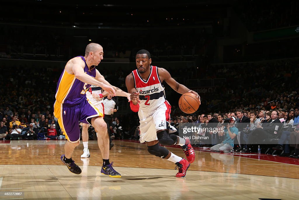 <a gi-track='captionPersonalityLinkClicked' href=/galleries/search?phrase=John+Wall&family=editorial&specificpeople=2265812 ng-click='$event.stopPropagation()'>John Wall</a> #2 of the Washington Wizards dribbles up the court against the Los Angeles Lakers during the game at the Verizon Center on November 26, 2013 in Washington, DC.