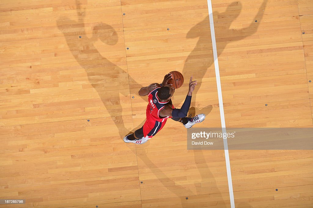 <a gi-track='captionPersonalityLinkClicked' href=/galleries/search?phrase=John+Wall&family=editorial&specificpeople=2265812 ng-click='$event.stopPropagation()'>John Wall</a> #2 of the Washington Wizards driblles the ball against the Philadelphia 76ers on November 6, 2013 in Philadelphia, Pennsylvania.