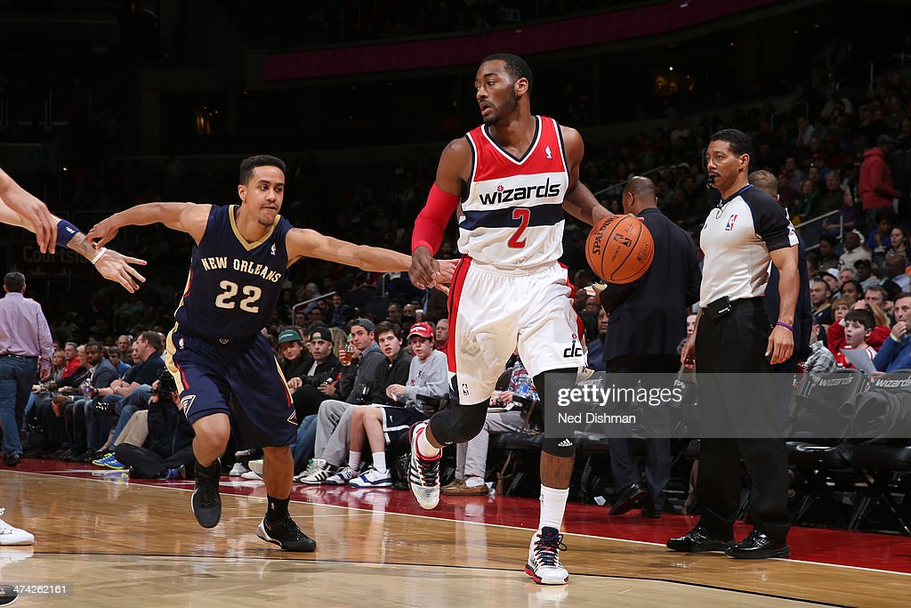 <a gi-track='captionPersonalityLinkClicked' href=/galleries/search?phrase=John+Wall&family=editorial&specificpeople=2265812 ng-click='$event.stopPropagation()'>John Wall</a> #2 of the Washington Wizards drives against Brian Roberts #22 of the New Orleans Pelicans during the game at the Verizon Center on February 22, 2014 in Washington, DC.