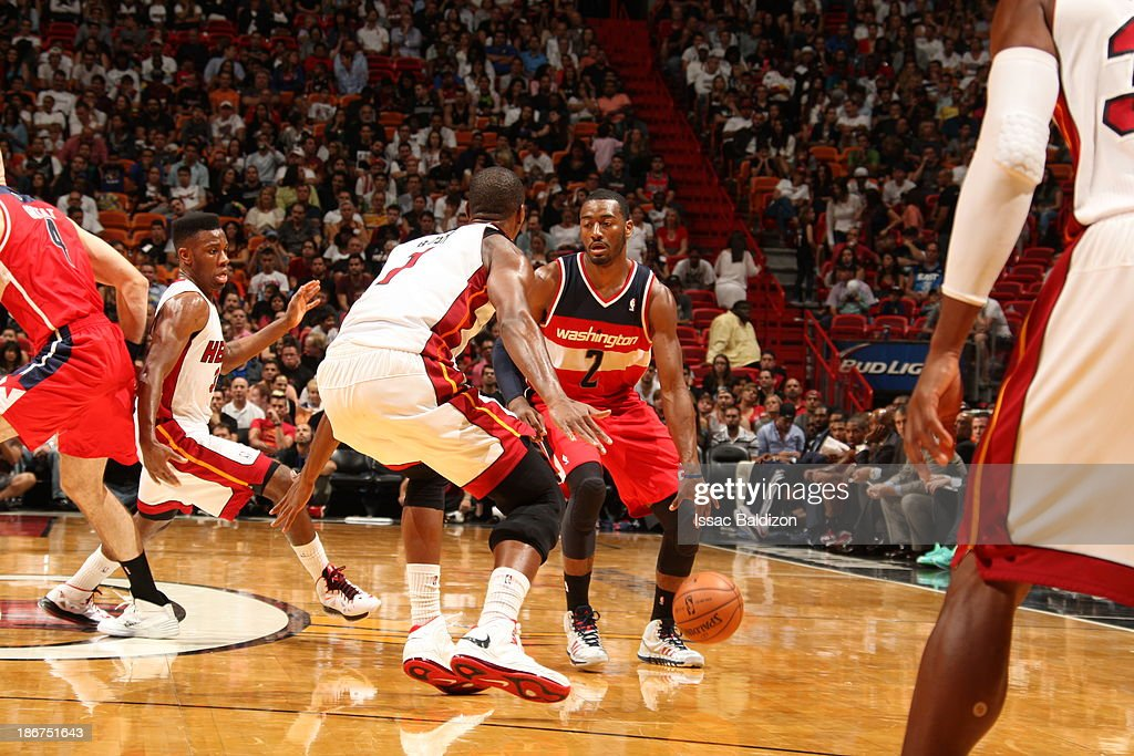 <a gi-track='captionPersonalityLinkClicked' href=/galleries/search?phrase=John+Wall&family=editorial&specificpeople=2265812 ng-click='$event.stopPropagation()'>John Wall</a> #2 of the Washington Wizards drives against <a gi-track='captionPersonalityLinkClicked' href=/galleries/search?phrase=Chris+Bosh&family=editorial&specificpeople=201574 ng-click='$event.stopPropagation()'>Chris Bosh</a> #1 of the Miami Heat on November 3, 2013 at American Airlines Arena in Miami, Florida.