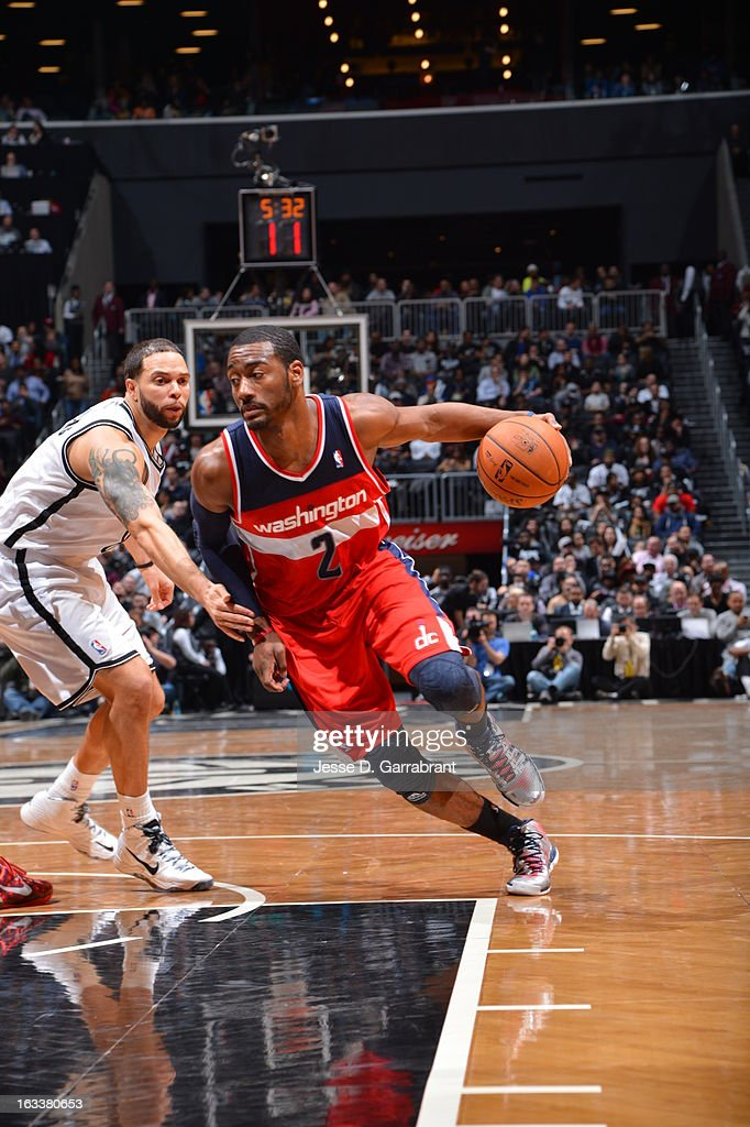 <a gi-track='captionPersonalityLinkClicked' href=/galleries/search?phrase=John+Wall&family=editorial&specificpeople=2265812 ng-click='$event.stopPropagation()'>John Wall</a> #2 of the Washington Wizards drives against <a gi-track='captionPersonalityLinkClicked' href=/galleries/search?phrase=Deron+Williams&family=editorial&specificpeople=203215 ng-click='$event.stopPropagation()'>Deron Williams</a> #8 of the Brooklyn Nets on March 8, 2013 at the Barclays Center in Brooklyn, New York.
