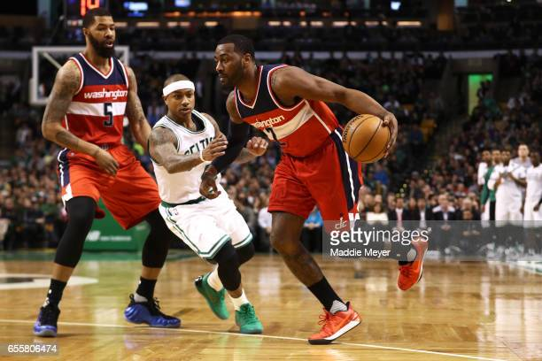 John Wall of the Washington Wizards drives against Isaiah Thomas of the Boston Celtics during the second quarter at TD Garden on March 20 2017 in...