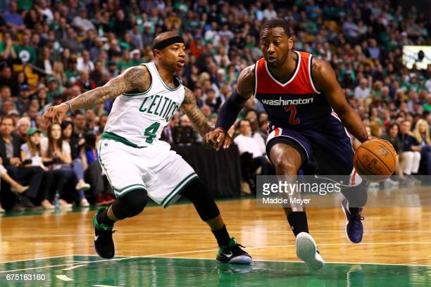 John Wall of the Washington Wizards drives against Isaiah Thomas of the Boston Celtics during the first quarter of Game One of the Eastern Conference...
