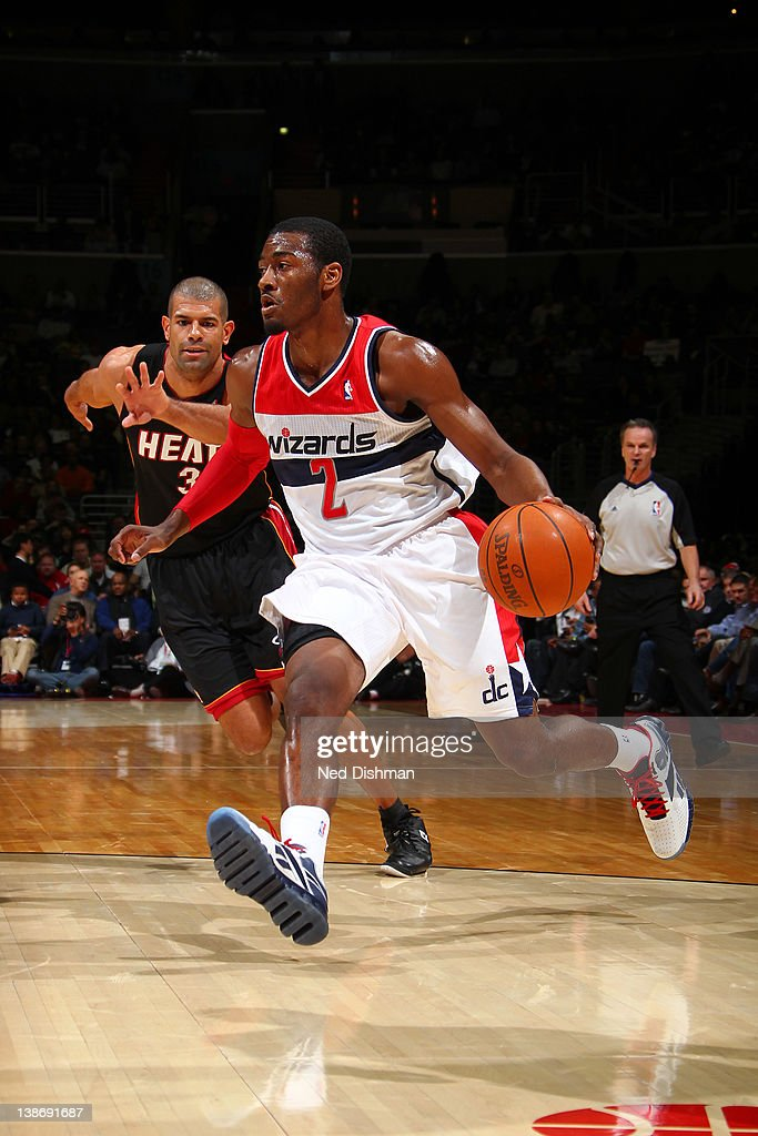 <a gi-track='captionPersonalityLinkClicked' href=/galleries/search?phrase=John+Wall&family=editorial&specificpeople=2265812 ng-click='$event.stopPropagation()'>John Wall</a> #2 of the Washington Wizards drives against <a gi-track='captionPersonalityLinkClicked' href=/galleries/search?phrase=Shane+Battier&family=editorial&specificpeople=201814 ng-click='$event.stopPropagation()'>Shane Battier</a> #31 of the Miami Heat during the game at the Verizon Center on February 10, 2012 in Washington, DC.