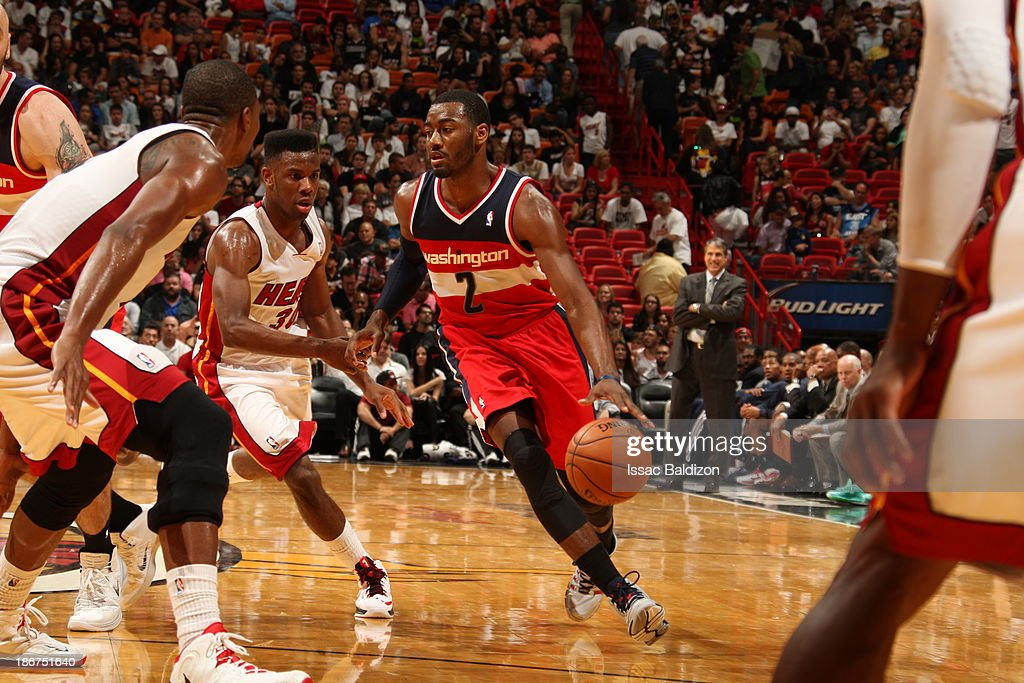 <a gi-track='captionPersonalityLinkClicked' href=/galleries/search?phrase=John+Wall&family=editorial&specificpeople=2265812 ng-click='$event.stopPropagation()'>John Wall</a> #2 of the Washington Wizards drives against <a gi-track='captionPersonalityLinkClicked' href=/galleries/search?phrase=Shane+Battier&family=editorial&specificpeople=201814 ng-click='$event.stopPropagation()'>Shane Battier</a> #31 of the Miami Heat on November 3, 2013 at American Airlines Arena in Miami, Florida.
