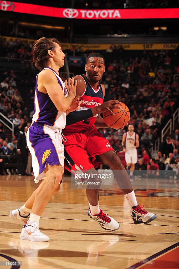 <a gi-track='captionPersonalityLinkClicked' href=/galleries/search?phrase=John+Wall&family=editorial&specificpeople=2265812 ng-click='$event.stopPropagation()'>John Wall</a> #2 of the Washington Wizards drives against <a gi-track='captionPersonalityLinkClicked' href=/galleries/search?phrase=Steve+Nash&family=editorial&specificpeople=201513 ng-click='$event.stopPropagation()'>Steve Nash</a> #13 of the Phoenix Suns in an NBA game played on February 20, 2012 at U.S. Airways Center in Phoenix, Arizona.