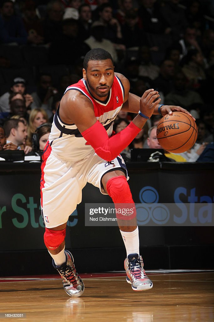 John Wall #2 of the Washington Wizards drives against the Charlotte Bobcats during the game at the Verizon Center on March 9, 2013 in Washington, DC.