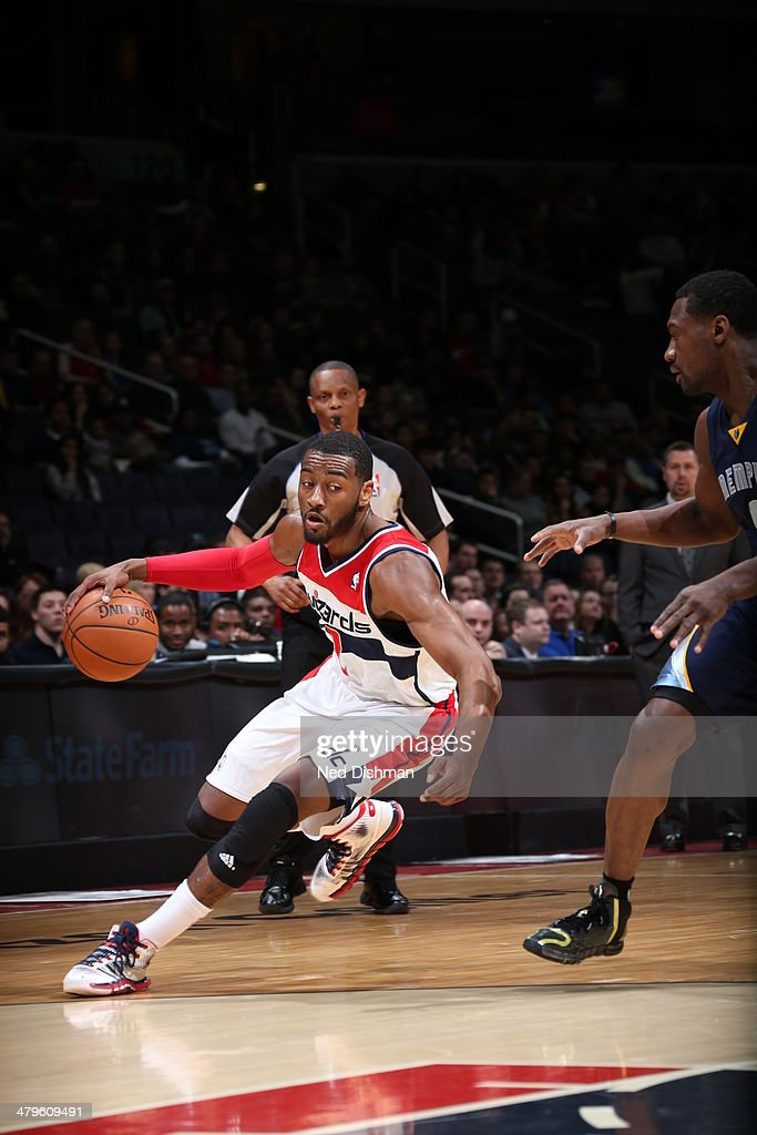 <a gi-track='captionPersonalityLinkClicked' href=/galleries/search?phrase=John+Wall&family=editorial&specificpeople=2265812 ng-click='$event.stopPropagation()'>John Wall</a> #2 of the Washington Wizards drives against the Memphis Grizzlies at the Verizon Center on March 3, 2014 in Washington, DC.