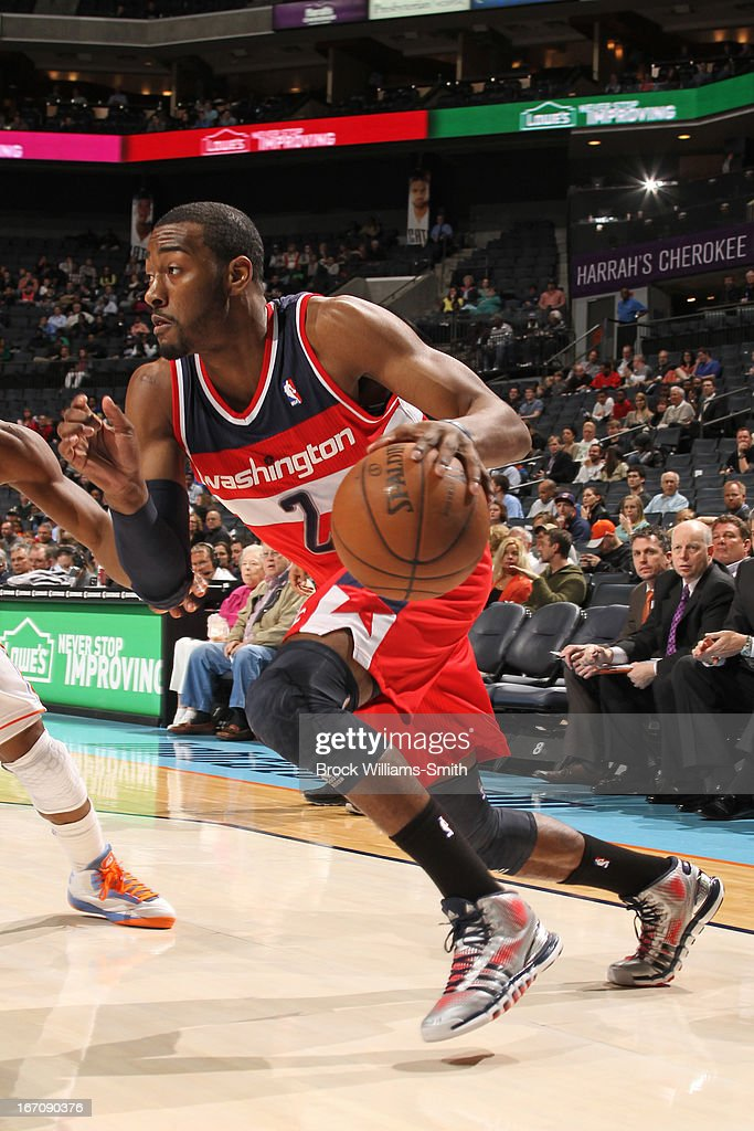 <a gi-track='captionPersonalityLinkClicked' href=/galleries/search?phrase=John+Wall&family=editorial&specificpeople=2265812 ng-click='$event.stopPropagation()'>John Wall</a> #2 of the Washington Wizards drives baseline against the Charlotte Bobcats at the Time Warner Cable Arena on March 18, 2013 in Charlotte, North Carolina.