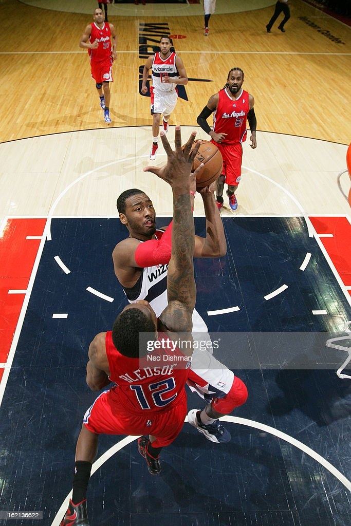 <a gi-track='captionPersonalityLinkClicked' href=/galleries/search?phrase=John+Wall&family=editorial&specificpeople=2265812 ng-click='$event.stopPropagation()'>John Wall</a> #2 of the Washington Wizards drives to the basket against <a gi-track='captionPersonalityLinkClicked' href=/galleries/search?phrase=Eric+Bledsoe&family=editorial&specificpeople=6480906 ng-click='$event.stopPropagation()'>Eric Bledsoe</a> #12 of the Los Angeles Clippers on February 4, 2013 at the Verizon Center in Washington, DC.