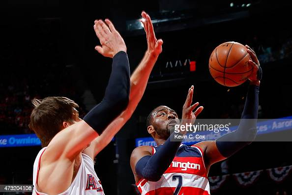 John Wall of the Washington Wizards drives to the basket against Kyle Korver of the Atlanta Hawks during Game Five of the Eastern Conference...