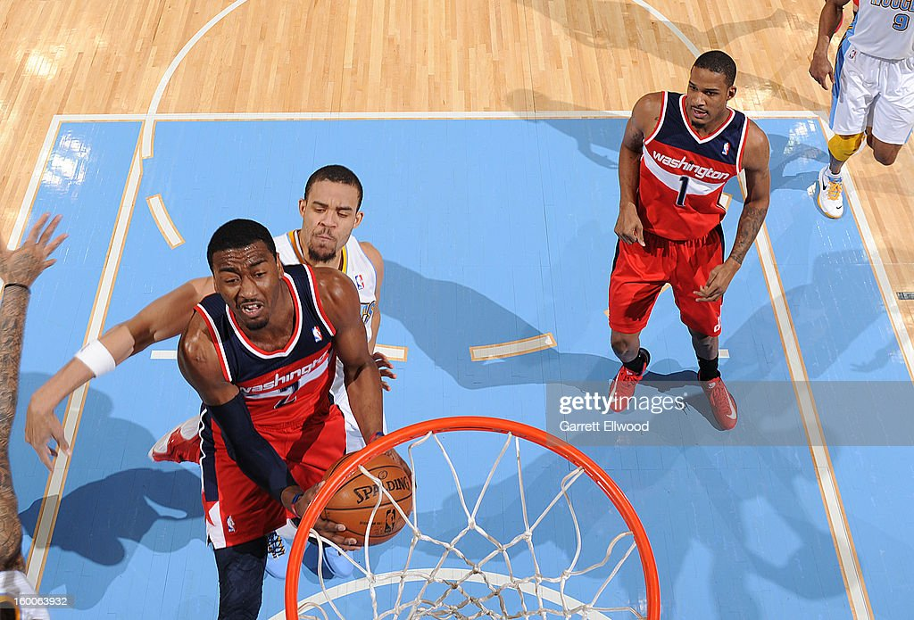 <a gi-track='captionPersonalityLinkClicked' href=/galleries/search?phrase=John+Wall&family=editorial&specificpeople=2265812 ng-click='$event.stopPropagation()'>John Wall</a> #2 of the Washington Wizards drives to the basket against <a gi-track='captionPersonalityLinkClicked' href=/galleries/search?phrase=JaVale+McGee&family=editorial&specificpeople=4195625 ng-click='$event.stopPropagation()'>JaVale McGee</a> #34 of the Denver Nuggets on January 18, 2013 at the Pepsi Center in Denver, Colorado.