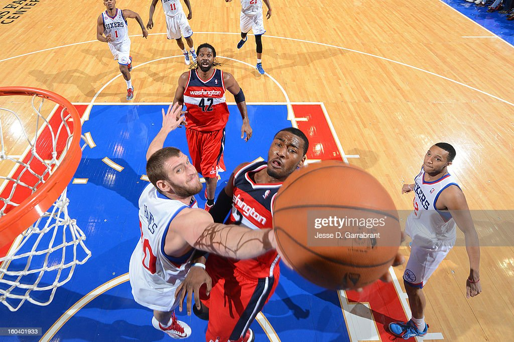 <a gi-track='captionPersonalityLinkClicked' href=/galleries/search?phrase=John+Wall&family=editorial&specificpeople=2265812 ng-click='$event.stopPropagation()'>John Wall</a> #2 of the Washington Wizards drives to the basket against <a gi-track='captionPersonalityLinkClicked' href=/galleries/search?phrase=Spencer+Hawes&family=editorial&specificpeople=3848319 ng-click='$event.stopPropagation()'>Spencer Hawes</a> #00 of the Philadelphia 76ers at the Wells Fargo Center on January 30, 2013 in Philadelphia, Pennsylvania.