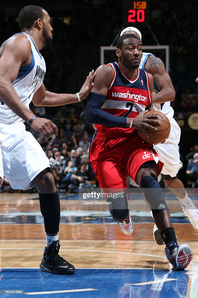 John Wall #2 of the Washington Wizards drives to the basket against Derrick Williams #7 of the Minnesota Timberwolves on March 6, 2013 at Target Center in Minneapolis, Minnesota.