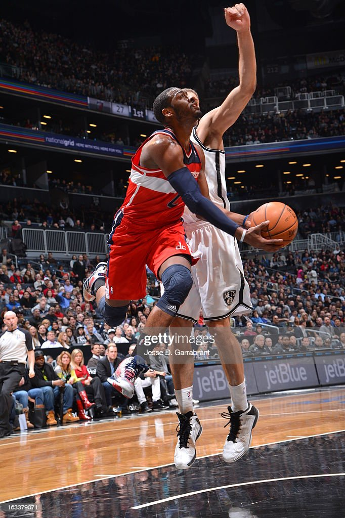 <a gi-track='captionPersonalityLinkClicked' href=/galleries/search?phrase=John+Wall&family=editorial&specificpeople=2265812 ng-click='$event.stopPropagation()'>John Wall</a> #2 of the Washington Wizards drives to the basket against <a gi-track='captionPersonalityLinkClicked' href=/galleries/search?phrase=Brook+Lopez&family=editorial&specificpeople=3847328 ng-click='$event.stopPropagation()'>Brook Lopez</a> #11 of the Brooklyn Nets on March 8, 2013 at the Barclays Center in Brooklyn, New York.