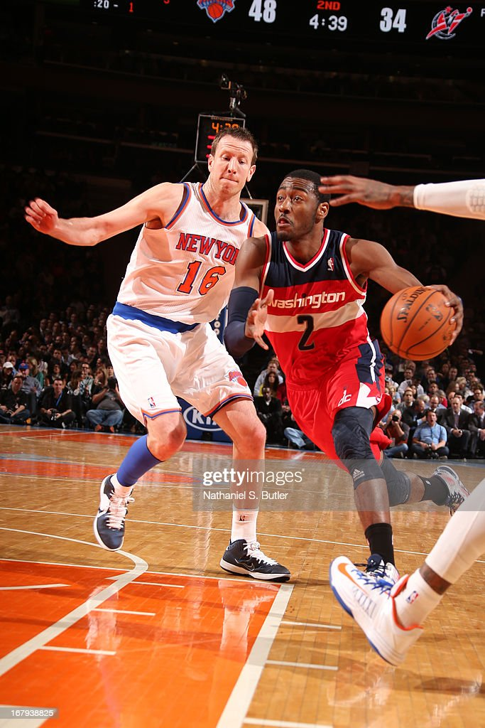 <a gi-track='captionPersonalityLinkClicked' href=/galleries/search?phrase=John+Wall&family=editorial&specificpeople=2265812 ng-click='$event.stopPropagation()'>John Wall</a> #2 of the Washington Wizards drives to the basket against <a gi-track='captionPersonalityLinkClicked' href=/galleries/search?phrase=Steve+Novak&family=editorial&specificpeople=693015 ng-click='$event.stopPropagation()'>Steve Novak</a> #16 of the New York Knicks on April 9, 2013 at Madison Square Garden in New York City.