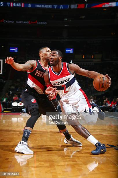 John Wall of the Washington Wizards drives to the basket against Damian Lillard of the Portland Trail Blazers during the game on January 16 2017 at...