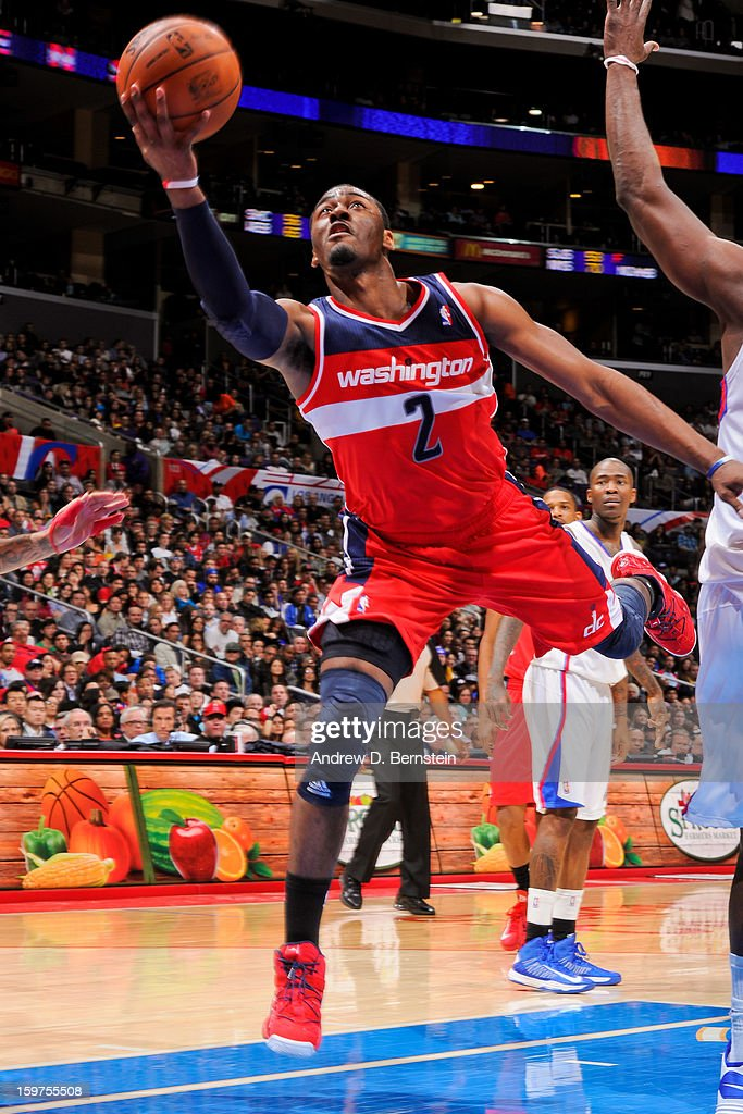 John Wall #2 of the Washington Wizards drives to the basket against the Los Angeles Clippers at Staples Center on January 19, 2013 in Los Angeles, California.