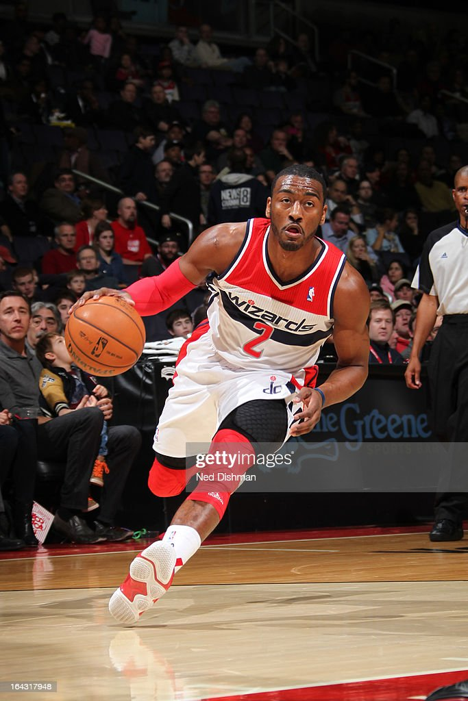 <a gi-track='captionPersonalityLinkClicked' href=/galleries/search?phrase=John+Wall&family=editorial&specificpeople=2265812 ng-click='$event.stopPropagation()'>John Wall</a> #2 of the Washington Wizards drives to the basket against the Philadelphia 76ers at the Verizon Center on March 3, 2013 in Washington, DC.