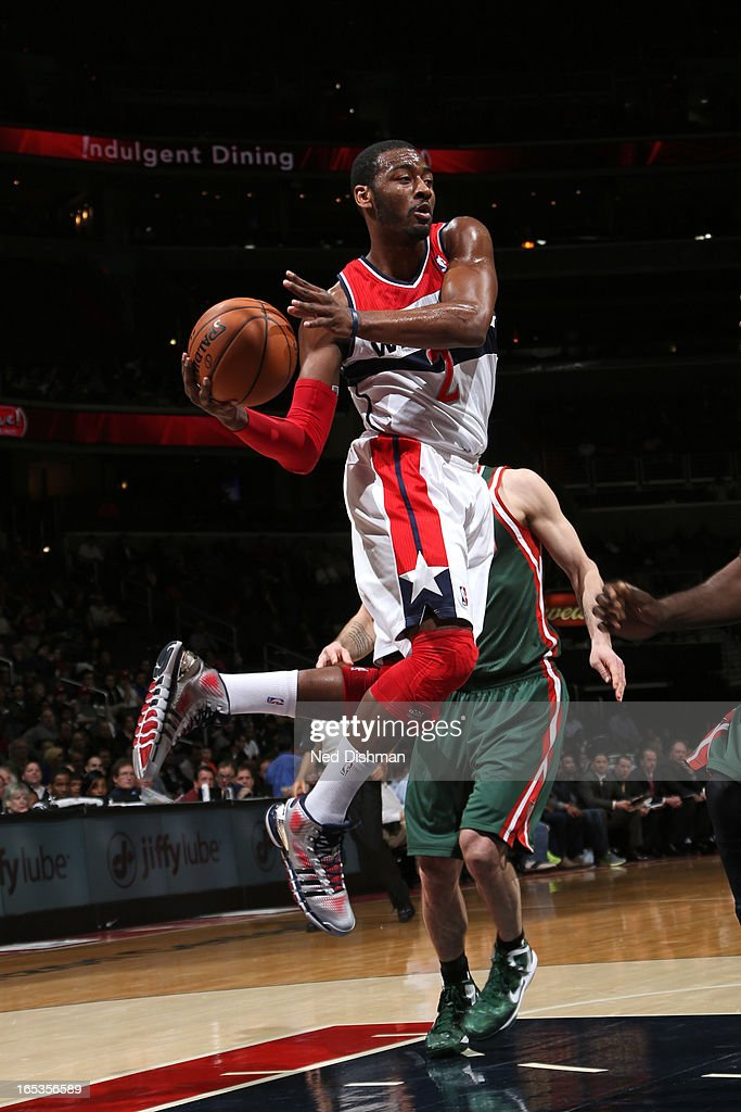 <a gi-track='captionPersonalityLinkClicked' href=/galleries/search?phrase=John+Wall&family=editorial&specificpeople=2265812 ng-click='$event.stopPropagation()'>John Wall</a> #2 of the Washington Wizards drives to the basket against the Milwaukee Bucks at the Verizon Center on March 13, 2013 in Washington, DC.