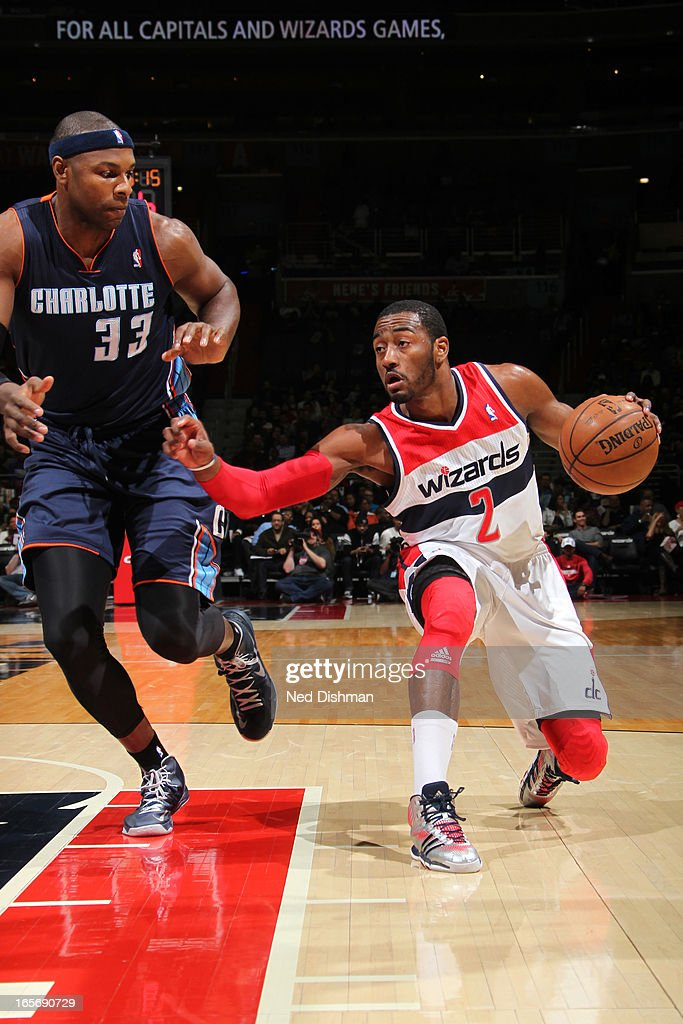 John Wall #2 of the Washington Wizards drives to the basket against the Charlotte Bobcats at the Verizon Center on March 9, 2013 in Washington, DC.