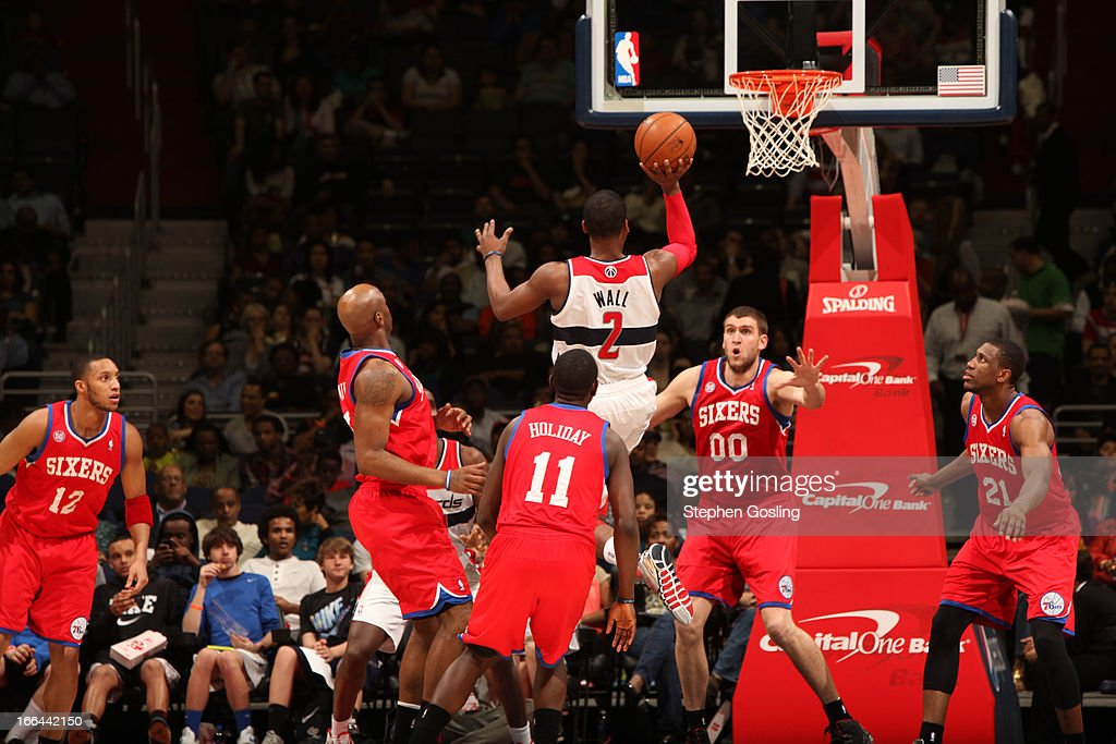 <a gi-track='captionPersonalityLinkClicked' href=/galleries/search?phrase=John+Wall&family=editorial&specificpeople=2265812 ng-click='$event.stopPropagation()'>John Wall</a> #2 of the Washington Wizards drives to the basket against the Philadelphia 76ers at the Verizon Center on April 12, 2013 in Washington, DC.
