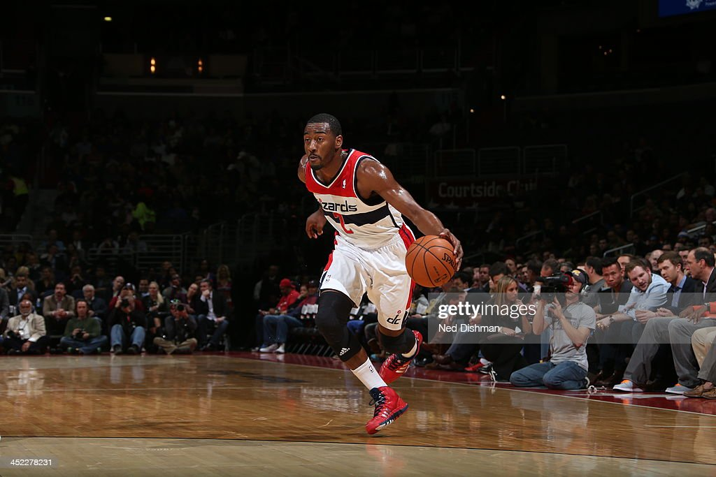 <a gi-track='captionPersonalityLinkClicked' href=/galleries/search?phrase=John+Wall&family=editorial&specificpeople=2265812 ng-click='$event.stopPropagation()'>John Wall</a> #2 of the Washington Wizards drives to the basket against the Minnesota Timberwolves during the game at the Verizon Center on November 19, 2013 in Washington, DC.
