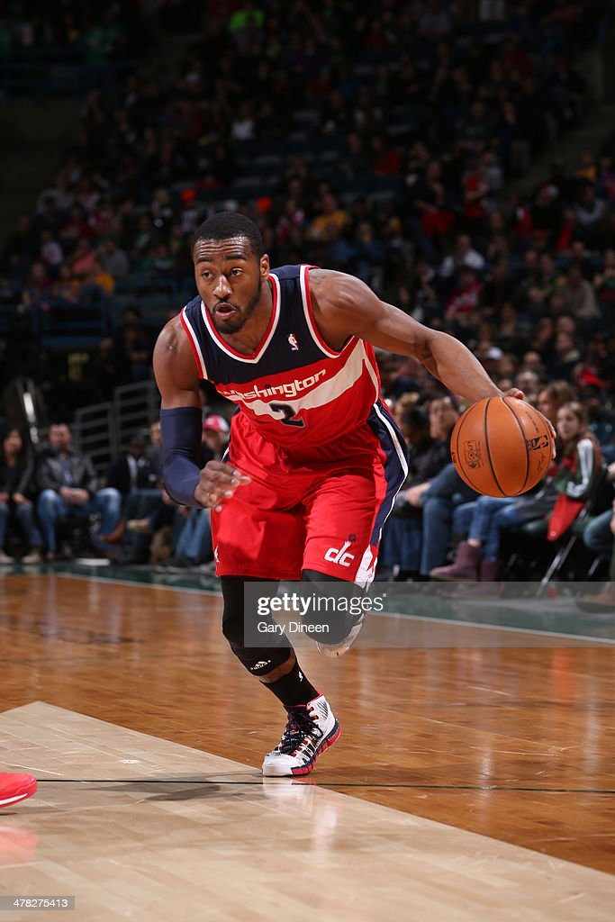 John Wall #2 of the Washington Wizards drives to the basket against the Milwaukee Bucks on March 8, 2014 at the BMO Harris Bradley Center in Milwaukee, Wisconsin.