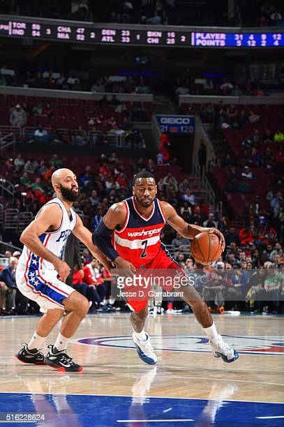 John Wall of the Washington Wizards drives to the basket against the Philadelphia 76ers at Wells Fargo Center on March 17 2016 in Philadelphia...