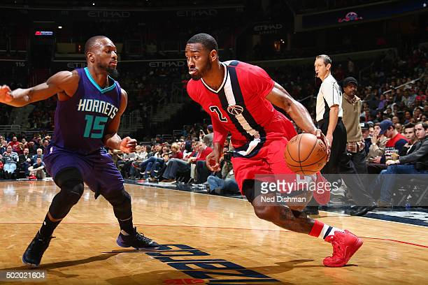 John Wall of the Washington Wizards drives to the basket during the game against the Charlotte Hornets on December 19 2015 at Verizon Center in...