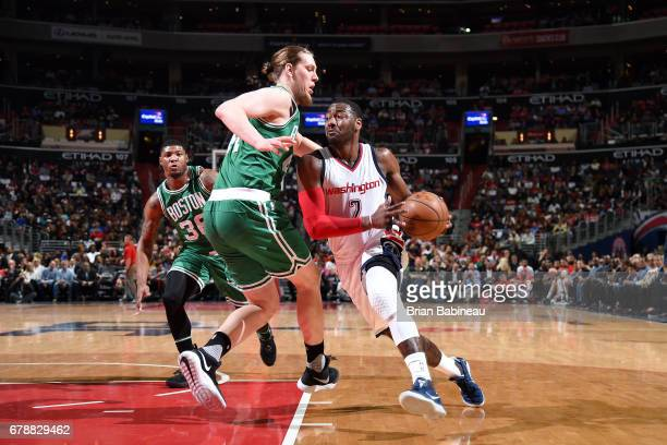 John Wall of the Washington Wizards drives to the basket during the game against the Boston Celtics during Game Three of the Eastern Conference...