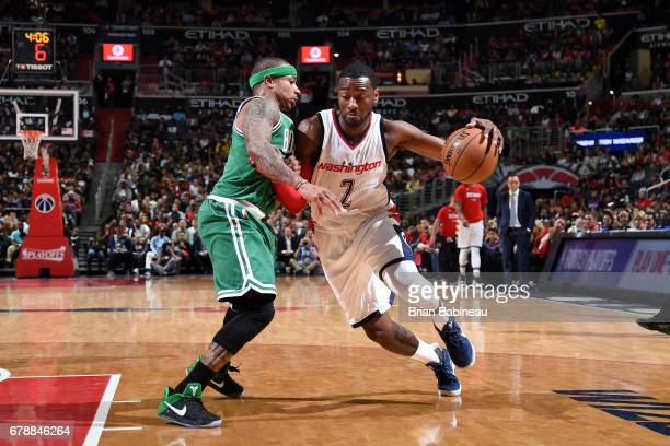 John Wall of the Washington Wizards drives to the basket during the game against Isaiah Thomas of the Boston Celtics during Game Three of the Eastern...