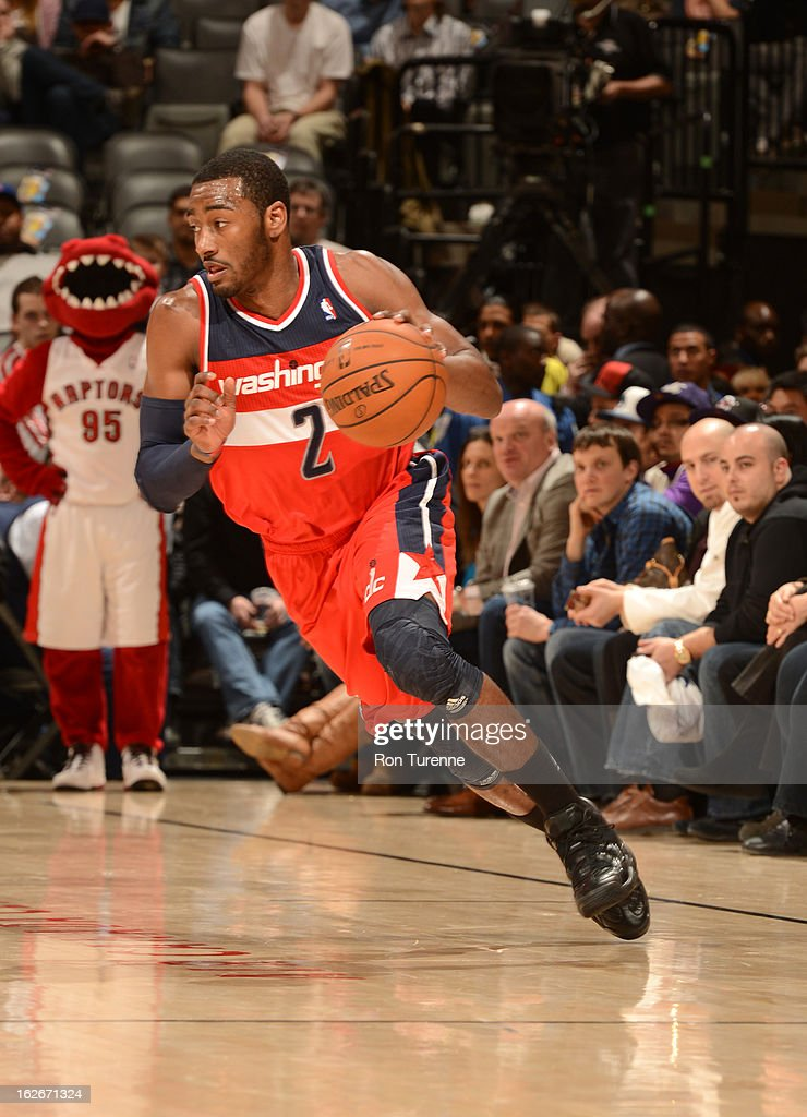 John Wall #2 of the Washington Wizards drives up court during the game between the Toronto Raptors and the Washington Wizards during the game on February 25, 2013 at the Air Canada Centre in Toronto, Ontario, Canada.
