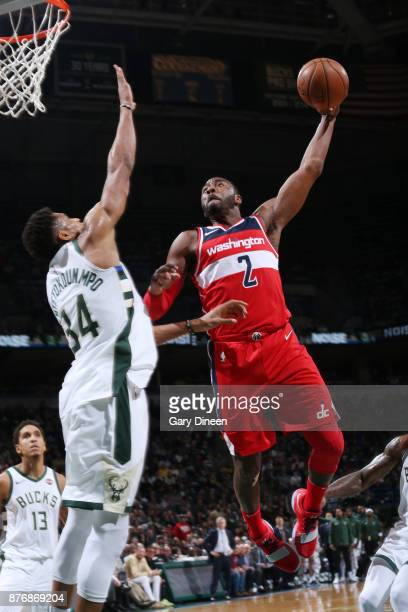 John Wall of the Washington Wizards dunks against Giannis Antetokounmpo of the Milwaukee Bucks on November 20 2017 at the BMO Harris Bradley Center...