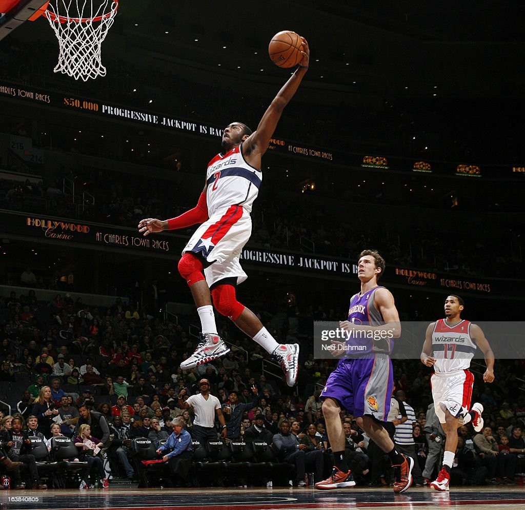 John Wall #2 of the Washington Wizards dunks against Goran Dragic #1 of the Phoenix Suns during the game at the Verizon Center on March 16, 2013 in Washington, DC.
