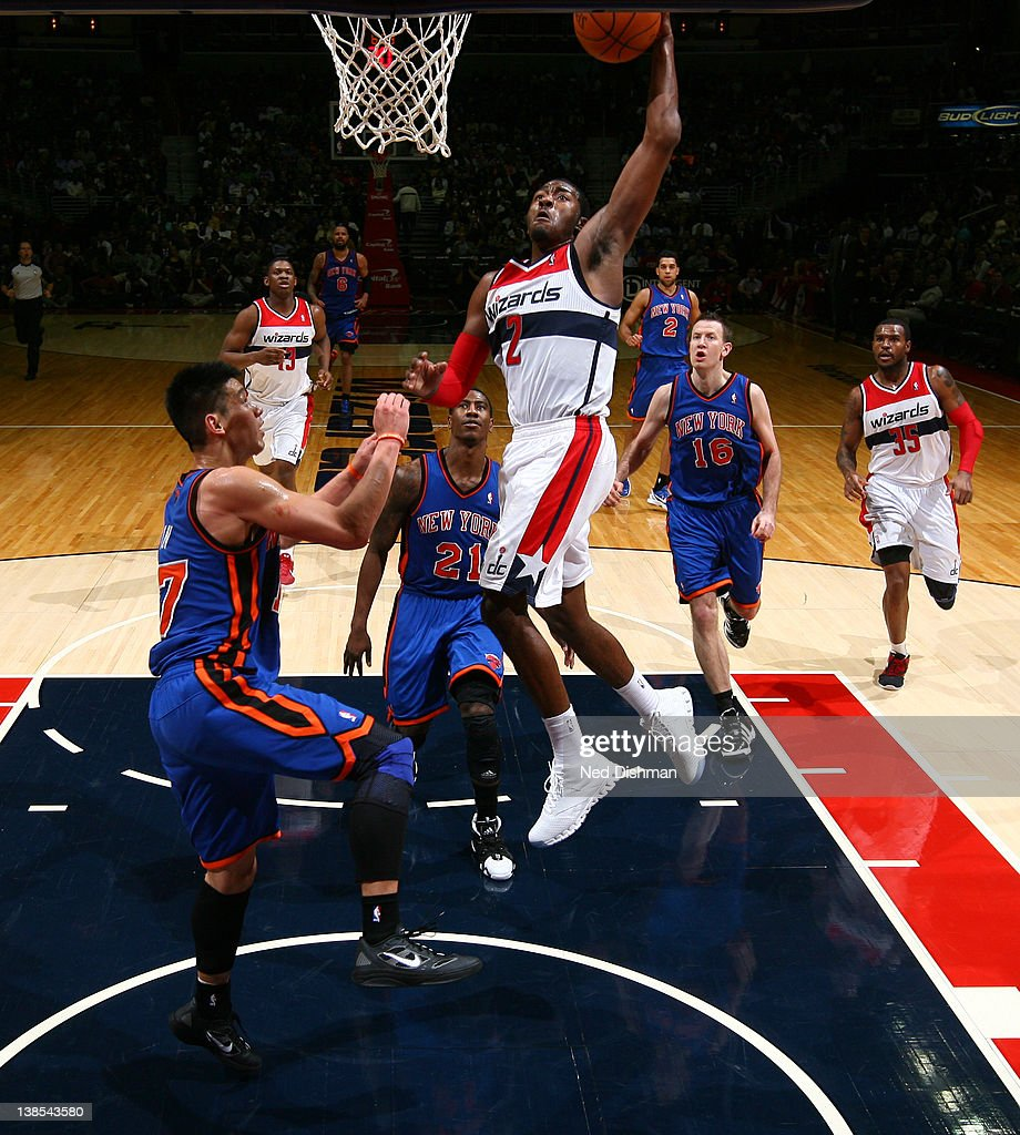 <a gi-track='captionPersonalityLinkClicked' href=/galleries/search?phrase=John+Wall&family=editorial&specificpeople=2265812 ng-click='$event.stopPropagation()'>John Wall</a> #2 of the Washington Wizards dunks against <a gi-track='captionPersonalityLinkClicked' href=/galleries/search?phrase=Jeremy+Lin&family=editorial&specificpeople=6669516 ng-click='$event.stopPropagation()'>Jeremy Lin</a> #17 of the New York Knicks during the game at the Verizon Center on February 8, 2012 in Washington, DC.