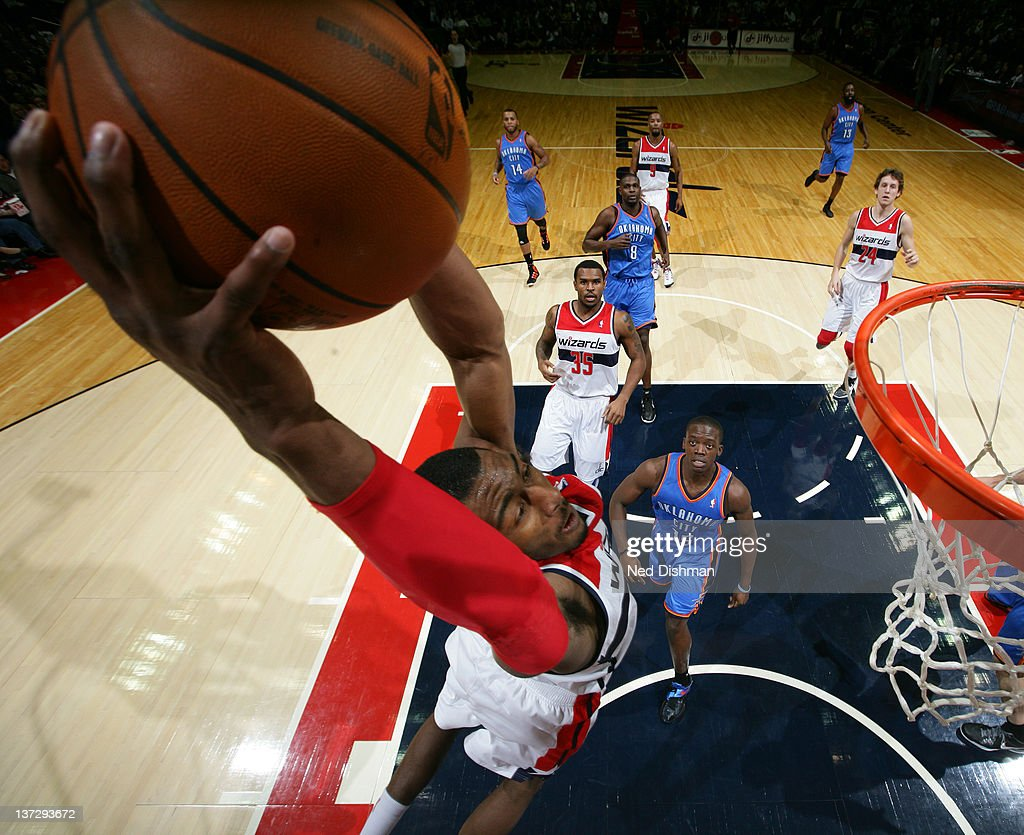<a gi-track='captionPersonalityLinkClicked' href=/galleries/search?phrase=John+Wall&family=editorial&specificpeople=2265812 ng-click='$event.stopPropagation()'>John Wall</a> #2 of the Washington Wizards dunks against Reggie Jackson #15 of the Oklahoma City Thunder during the game at the Verizon Center on January 18, 2012 in Washington, DC.