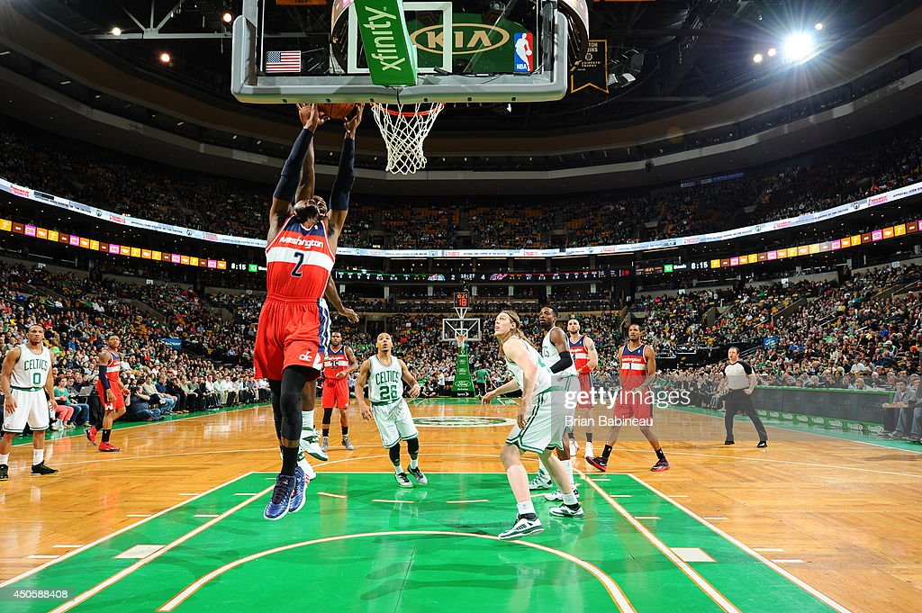 John Wall #2 of the Washington Wizards dunks against the Boston Celtics on April 16, 2014 at the TD Garden in Boston, Massachusetts.