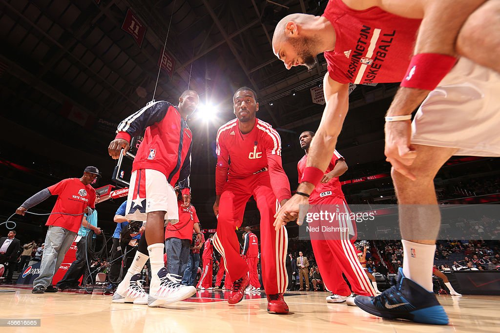 <a gi-track='captionPersonalityLinkClicked' href=/galleries/search?phrase=John+Wall&family=editorial&specificpeople=2265812 ng-click='$event.stopPropagation()'>John Wall</a> #2 of the Washington Wizards enters the court during pre-game announcements against the Los Angeles Clippers during the game at the Verizon Center on December 14, 2013 in Washington, DC.