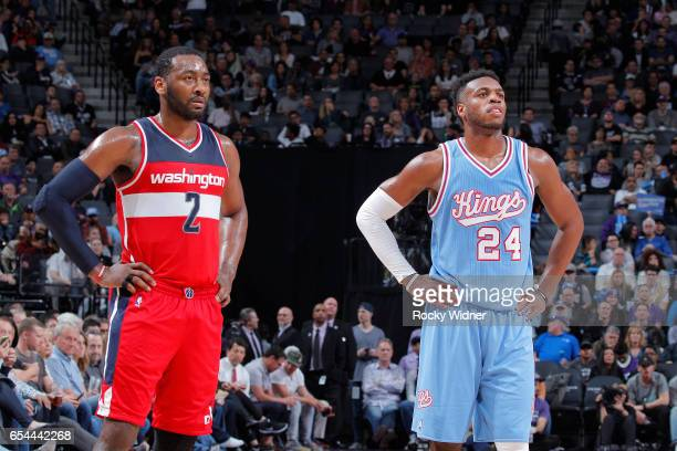 John Wall of the Washington Wizards faces off against Buddy Hield of the Sacramento Kings on March 10 2017 at Golden 1 Center in Sacramento...