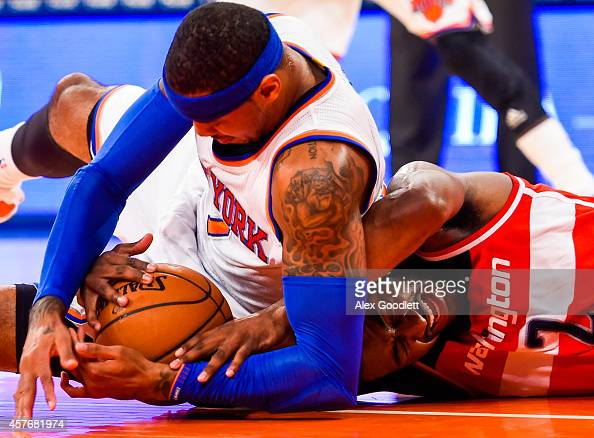 John Wall of the Washington Wizards fights for the ball with Carmelo Anthony of the New York Knicks in a preseason game at Madison Square Garden on...