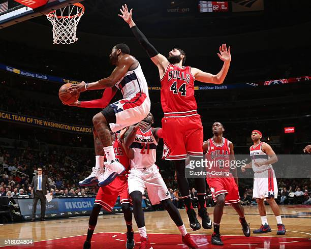 John Wall of the Washington Wizards goes for the layup against Nikola Mirotic of the Chicago Bullsduring the game on March 16 2016 at Verizon Center...