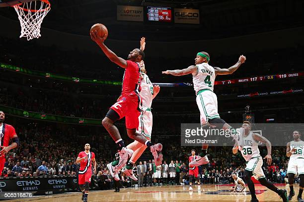 John Wall of the Washington Wizards goes for the layup during the game against the Boston Celtics on January 16 2016 at Verizon Center in Washington...