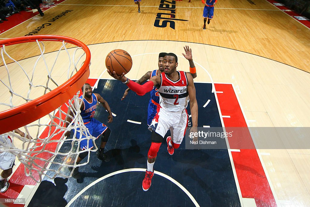 <a gi-track='captionPersonalityLinkClicked' href=/galleries/search?phrase=John+Wall&family=editorial&specificpeople=2265812 ng-click='$event.stopPropagation()'>John Wall</a> #2 of the Washington Wizards goes to the basket against <a gi-track='captionPersonalityLinkClicked' href=/galleries/search?phrase=Raymond+Felton&family=editorial&specificpeople=209141 ng-click='$event.stopPropagation()'>Raymond Felton</a> #2 and <a gi-track='captionPersonalityLinkClicked' href=/galleries/search?phrase=Iman+Shumpert&family=editorial&specificpeople=5042486 ng-click='$event.stopPropagation()'>Iman Shumpert</a> #21 of the New York Knicks at the Verizon Center on March 1, 2013 in Washington, DC.