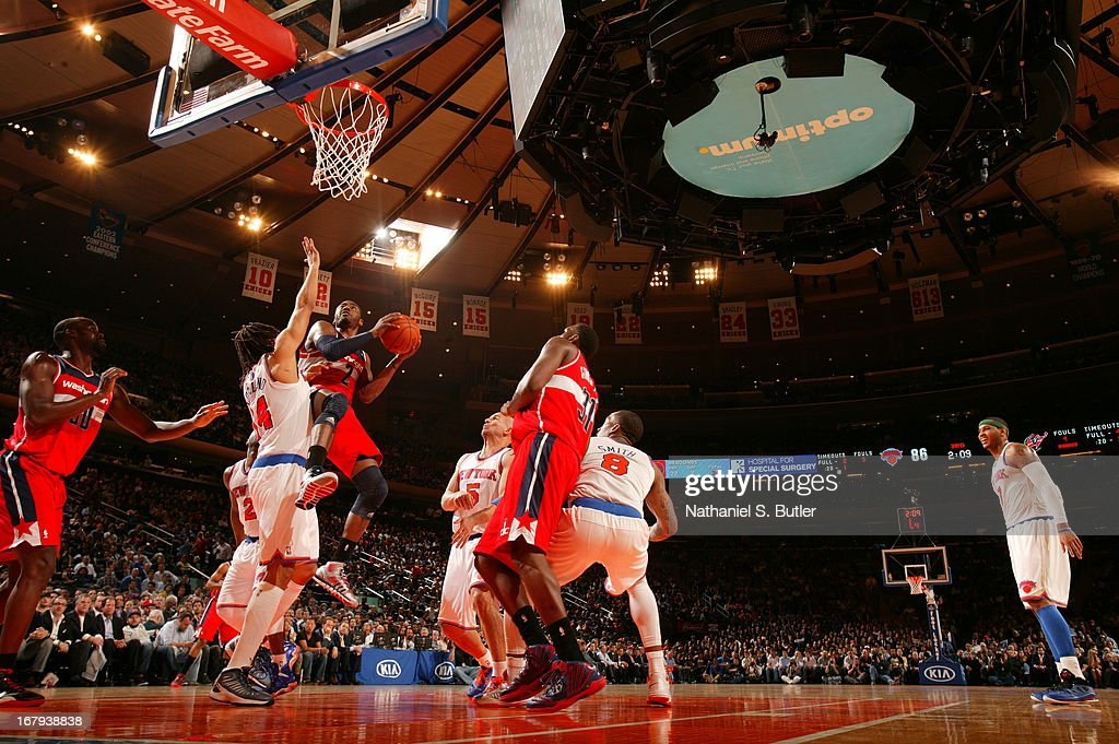 <a gi-track='captionPersonalityLinkClicked' href=/galleries/search?phrase=John+Wall&family=editorial&specificpeople=2265812 ng-click='$event.stopPropagation()'>John Wall</a> #2 of the Washington Wizards goes to the basket against <a gi-track='captionPersonalityLinkClicked' href=/galleries/search?phrase=Chris+Copeland&family=editorial&specificpeople=833969 ng-click='$event.stopPropagation()'>Chris Copeland</a> #14 of the New York Knicks on April 9, 2013 at Madison Square Garden in New York City.