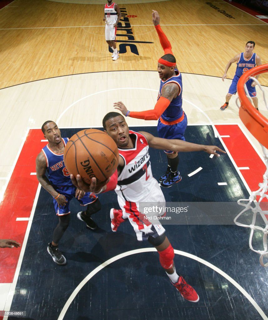 <a gi-track='captionPersonalityLinkClicked' href=/galleries/search?phrase=John+Wall&family=editorial&specificpeople=2265812 ng-click='$event.stopPropagation()'>John Wall</a> #2 of the Washington Wizards goes to the basket against <a gi-track='captionPersonalityLinkClicked' href=/galleries/search?phrase=J.R.+Smith&family=editorial&specificpeople=201766 ng-click='$event.stopPropagation()'>J.R. Smith</a> #8 and <a gi-track='captionPersonalityLinkClicked' href=/galleries/search?phrase=Carmelo+Anthony&family=editorial&specificpeople=201494 ng-click='$event.stopPropagation()'>Carmelo Anthony</a> #7 of the New York Knicks during the game at the Verizon Center on February 6, 2013 in Washington, DC.