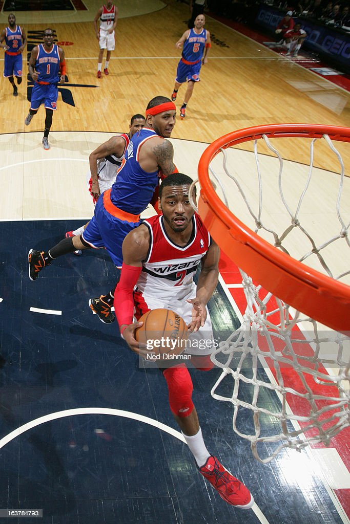 John Wall #2 of the Washington Wizards goes to the basket against Carmelo Anthony #7 of the New York Knicks at the Verizon Center on March 1, 2013 in Washington, DC.