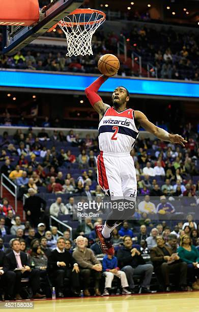 John Wall of the Washington Wizards goes up for a dunk against the Los Angeles Lakers during the first quarter at Verizon Center on November 26 2013...