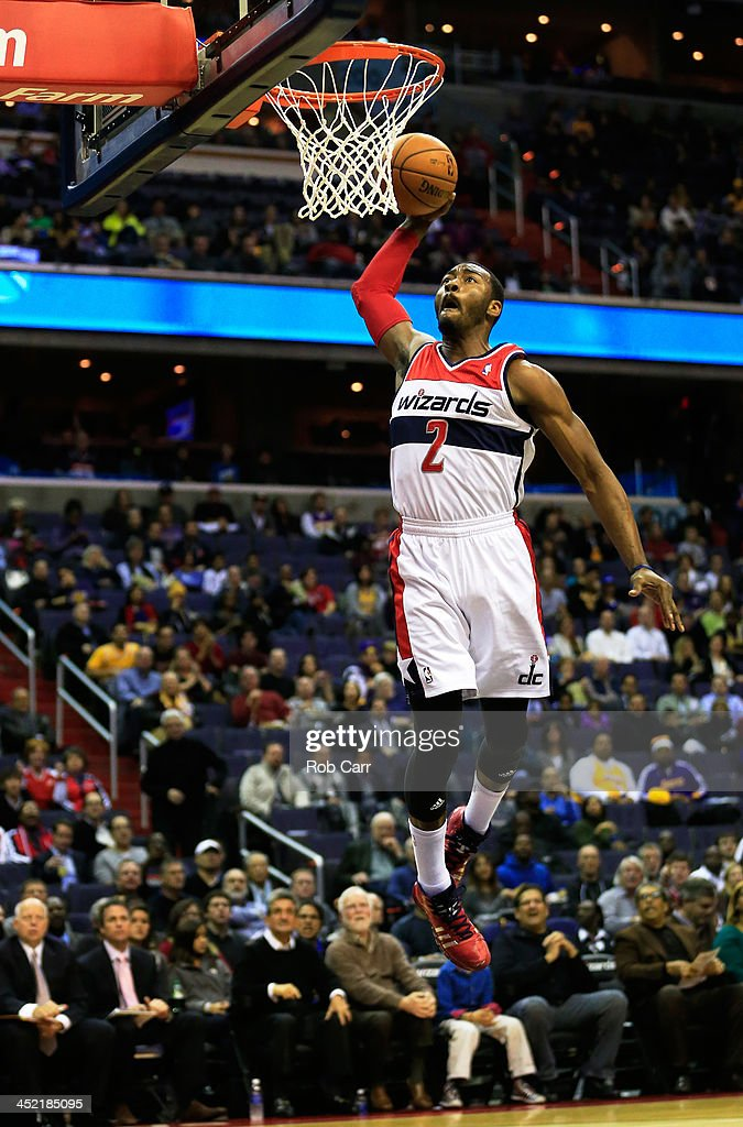 <a gi-track='captionPersonalityLinkClicked' href=/galleries/search?phrase=John+Wall&family=editorial&specificpeople=2265812 ng-click='$event.stopPropagation()'>John Wall</a> #2 of the Washington Wizards goes up for a dunk against the Los Angeles Lakers during the first quarter at Verizon Center on November 26, 2013 in Washington, DC.